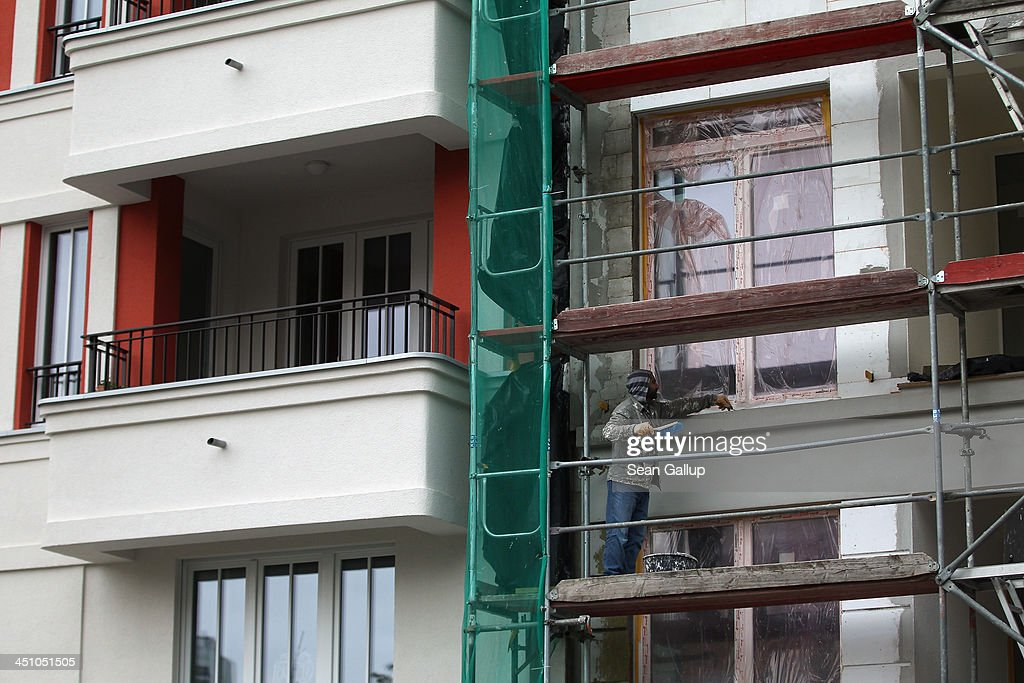 Apartment Building Loans low interest rates spark construction boom photos and images