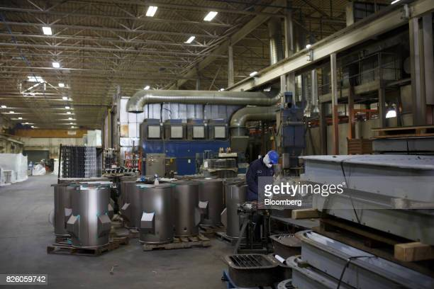 A worker stands on the production floor at the Automatic Coating Ltd facility in Toronto Ontario Canada on Wednesday Jan 11 2017 Statistics Canada is...