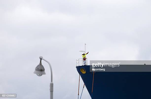 A worker stands on the prow of the Oak Spirit liquefied natural gas tanker as it is moored at Chubu Electric Power Co's Joetsu thermal power station...