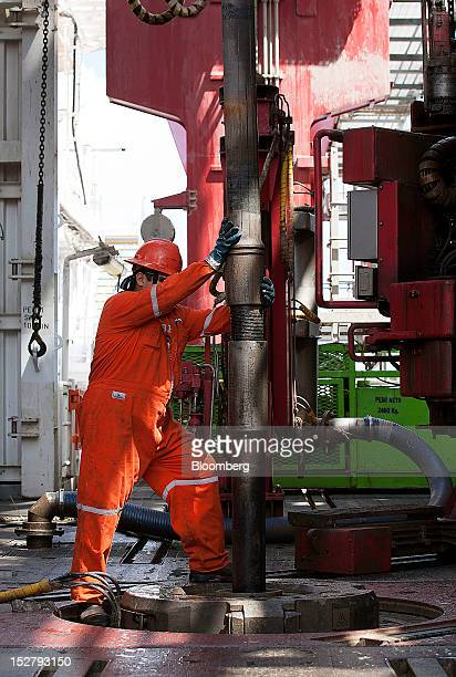 A worker stands on the swivel during drilling on the Petroleos Mexicanos Bicentennial deep sea crude oil platform in the waters off Tamaulipas Mexico...
