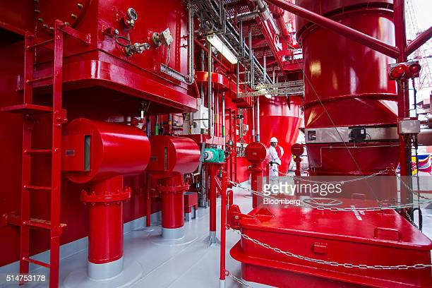 A worker stands onboard the Floatel Triumph a semisubmersible accommodation rig operated by Floatel International Ltd and developed by Keppel...