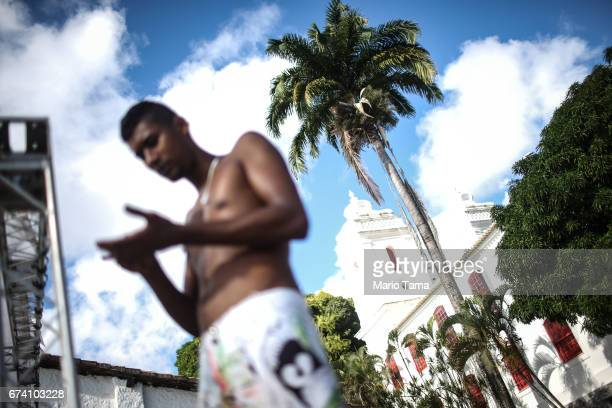 A worker stands outside the Museum of Modern Arts on April 18 2015 in Salvador Brazil