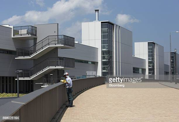 A worker stands outside the under construction Toyosu Market in Tokyo Japan on Wednesday Aug 31 2016 Yuriko Koike governor of Tokyo announced...