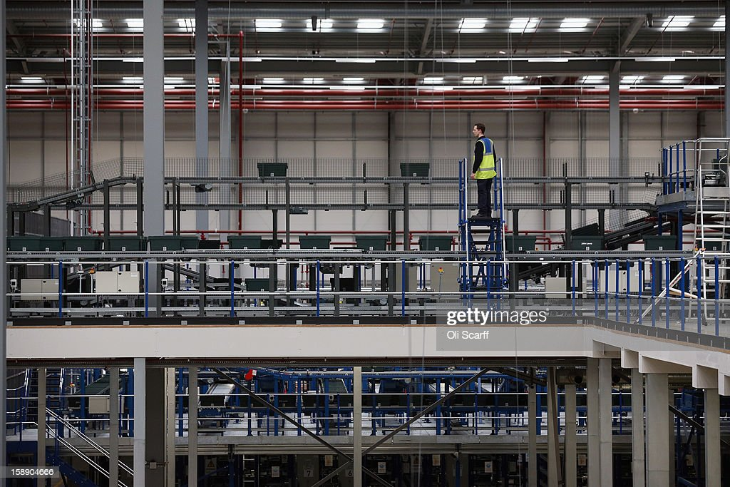 A worker stands up high in the giant semi-automated distribution centre where the company's partners process the online orders for the John Lewis department store on January 3, 2013 in Milton Keynes, England. John Lewis has published their sales report for the five weeks prior December 29, 2012 which showed online sales had increased by 44.3 per cent over the same period in 2011. Purchases from their website Johnlewis.com now account for one quarter of all John Lewis business.