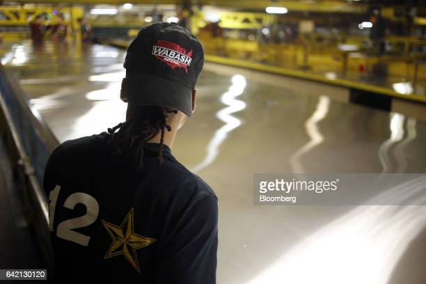 A worker stands while assembling the roof for a semi trailer on the factory floor at the Wabash National Corp manufacturing facility in Lafayette...