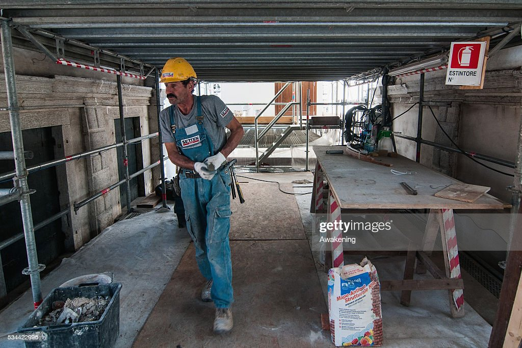A worker starts to work during the renovation of the Rialto Bridge on May 26, 2016 in Venice, Italy. Site visits were organized to see the renovation of the Rialto bridge to coincide with the 15th Biennale of Architecture in Venice.