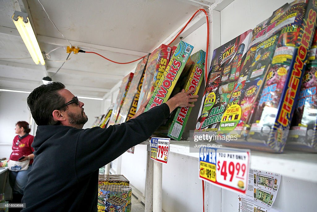 A worker stocks shelves with boxes of fireworks at the Camp St. Andrews fireworks stand on July 3, 2014 in San Bruno, California. As California's historic drought continues and fire danger is at severe levels, fire departments in the greater San Francisco Bay Area are on heightened alert as vendors in select cities in Santa Clara, San Mateo and Alameda counties sell fireworks ahead of the Fourth of July holiday.