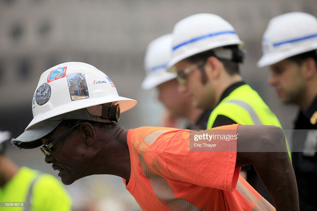 A worker strains to see remnants of what is thought to be an 18th century ship at the site Ground Zero Construction Site in July 15, 2010 New York City. The wood hulled vessel is approximately 30 feet long and was found 20 to 30 feet below street level on Tuesday morning.