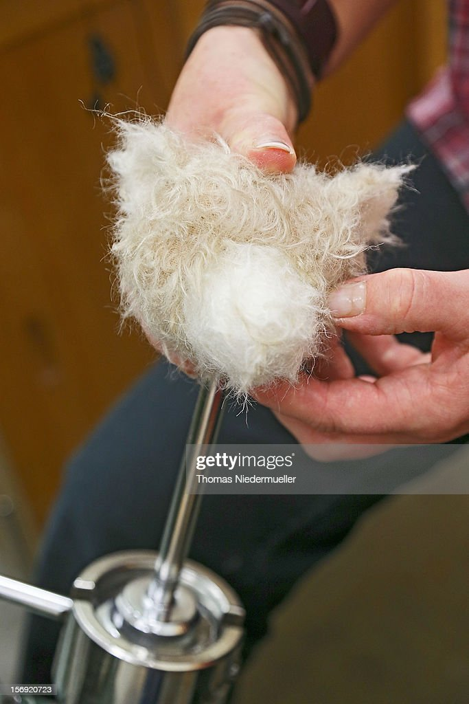 A worker stuffs teddy bear parts at the Steiff stuffed toy factory on November 23 2012 in Giengen an der Brenz Germany Founded by seamstress...