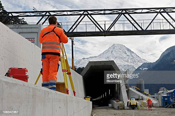 A worker surveys the northern entrance to the Gotthard railway tunnel in Erstfeld Switzerland on Wednesday Oct 27 2010 When completed the tunnel will...