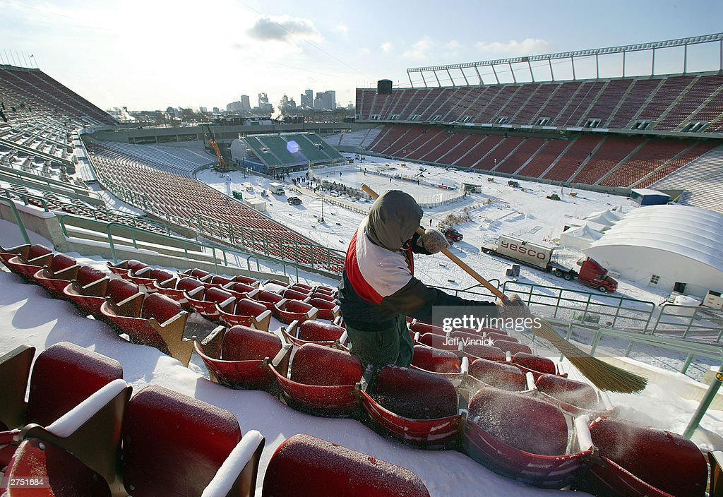 http://media.gettyimages.com/photos/worker-sweepes-snow-off-the-upper-level-seats-as-the-montreal-on-an-picture-id2751684
