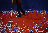 A worker sweeps confetti during the Republican National Convention in Cleveland Ohio US on Thursday July 21 2016 This evening marks the last night of...