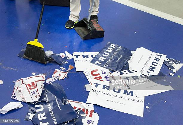 A worker sweeps the floor following a rally with Republican presidential candidate Donald Trump at Macomb Community College on March 4 2016 in Warren...