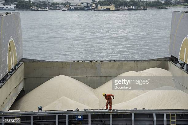 A worker sweeps the rail of a ship loaded with sugar for export at the Port of Santos in Santos Brazil on Tuesday Nov 10 2015 Sugar prices have...