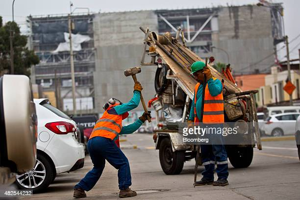 A worker swings a sledgehammer at the construction site of the Banco de la Nacion state bank headquarters building in the San Borja neighborhood of...