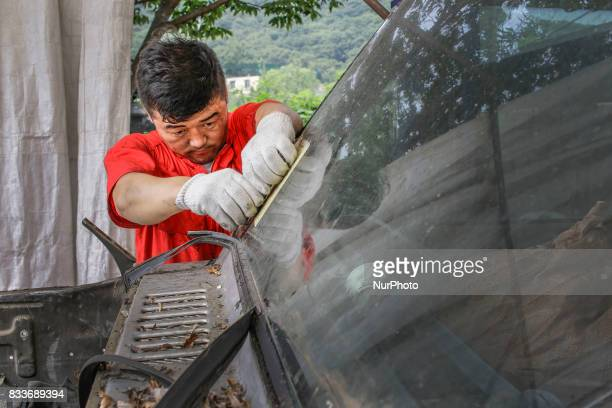 Worker take apart old gallopper vehicle at mohenic garages yard in Paju South Korea A 20yearold beat up Hyundai SUV isn't anyone's idea of a dream...