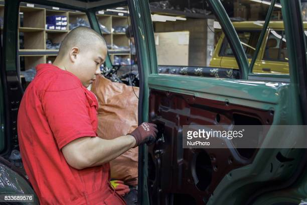 Worker take confirm to coating side at mohenic garages in Paju South Korea A 20yearold beat up Hyundai SUV isn't anyone's idea of a dream car But...