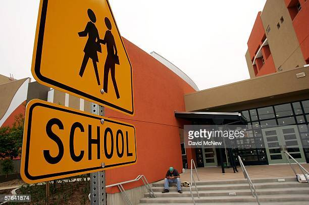 A worker takes a lunch break during construction of a new school May 17 2006 in the Los Angelesarea city of Maywood California In November voters...