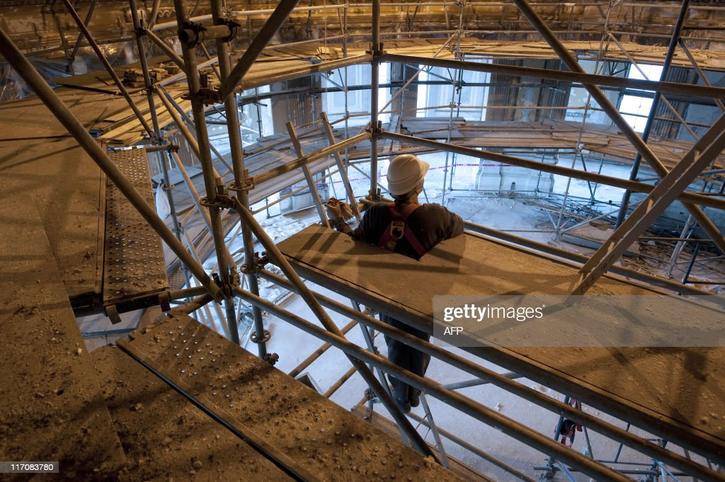 A worker takes part in the restoration of the Carrasco Hotel and Casino, built in 1921 and declared historical heritage, in Montevideo on May 27, 2011. French company Sofitel will manage the hotel from July 2012 at the end of the works, which costs around 60 million dollars.