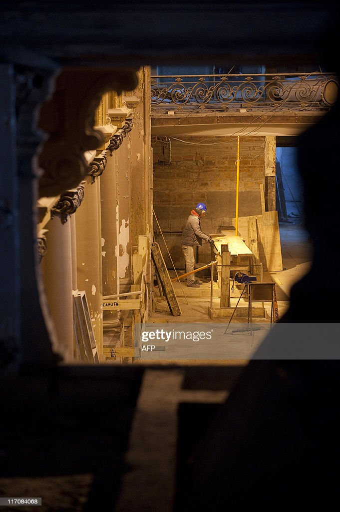 A worker takes part in the restoration of the Carrasco Hotel and Casino in Montevideo on June 10, 2011. French company Sofitel will manage the hotel from July 2012 at the end of the works, which costs around 60 million dollars. AFP PHOTO/Pablo PORCIUNCULA