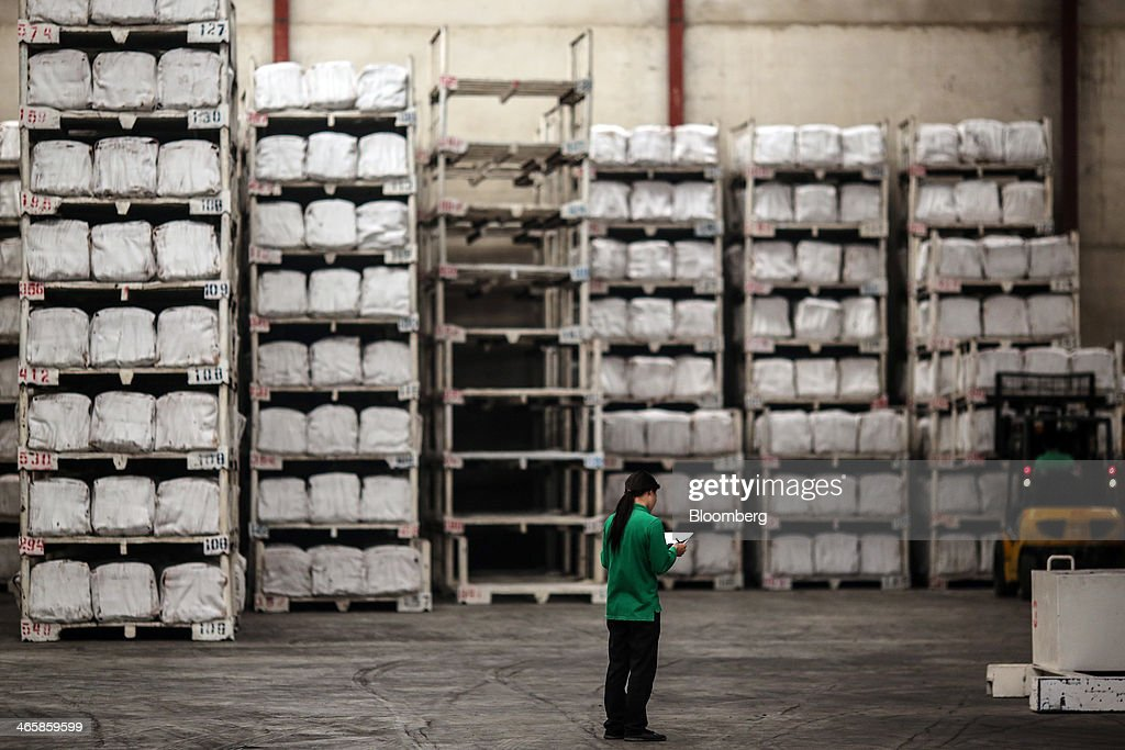 A worker takes stock of packaged bundles of smoked rubber sheets in the warehouse at the Thai Hua Rubber Pcl factory in Samnuktong, Rayong province, Thailand, on Wednesday, Jan. 29, 2014. Rubber production in Thailand, the world's largest exporter, may decline as growers from the main producing regions join protests seeking to overthrow the government, according to Von Bundit Co. Photographer: Dario Pignatelli/Bloomberg via Getty Images