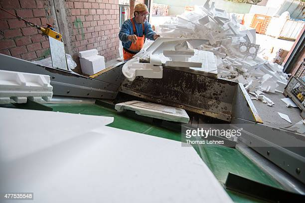 A worker takes white styrofoam of packaging to conveyor at the 'DRZ Darmstaedter Recycling Zentrum GmbH' on June 17 2015 in Darmstadt Germany It will...