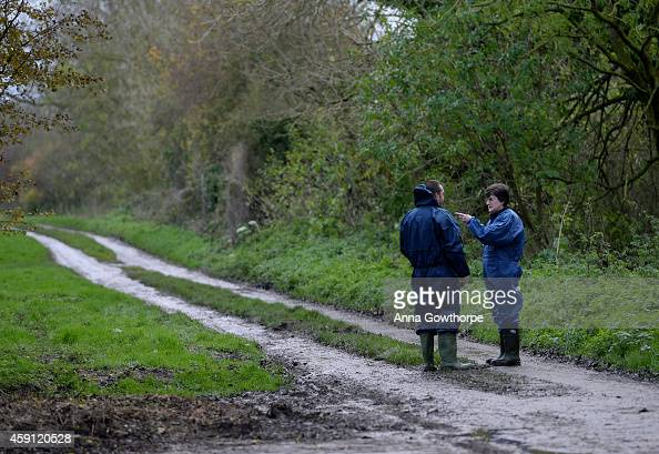 DEFRA worker talks to another worker outside a farm near Nafferton East Yorkshire where a strain of bird flu has been confirmed on November 17 2014...