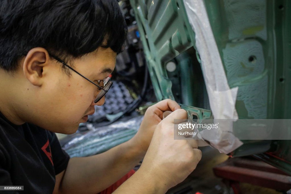 "Worker tape marking for inner coating at mohenic garages in Paju, South Korea. A 20-year-old beat up Hyundai SUV isn't anyone's idea of a dream car. But used Hyundai Gallopers, priced between $2,000 to $3,000 at second-hand car markets, are making a comeback , reborn as upwards $80,000 luxury vehicles at the hand of former furniture designer Henie Kim. Kim is now the CEO of Mohenic Garages, a car rebuilding company based in Paju has transformed the boxy classic into one of South Korea's most highly-desired cars. ""As a former designer, I wanted make everything perfect."" The remade ""Mohenic G"", as they're known, take their design cues from the 1990s and come in a variety of custom colors from ""mint racing green"" to ""midnight cerulean blue"". Demand for the ""Mohenic G"" has steadily risen, and the waitlist is long. Since 2013, only 43 cars have been rebuilt and 48 customers are on a waiting list. Production is slow though since the company expanded, they're able to produce 30 cars a year, or about 2 cars a month. A team of two dozen workers transform each car in a meticulous process that includes prying the car cabin from its frame, sanding, removing corrosive substances, polishing and painting."