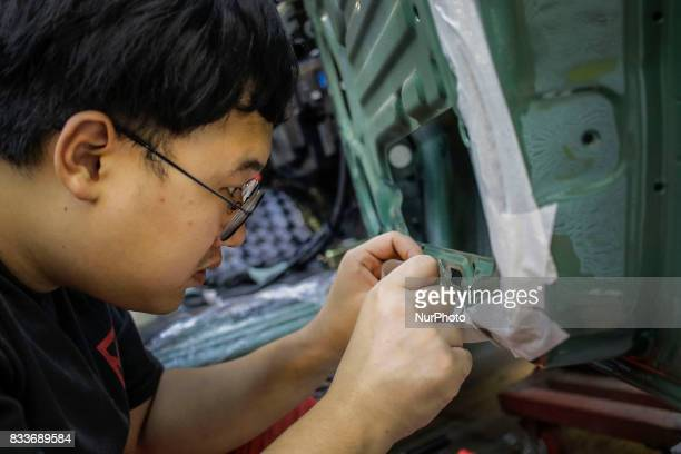 Worker tape marking for inner coating at mohenic garages in Paju South Korea A 20yearold beat up Hyundai SUV isn't anyone's idea of a dream car But...
