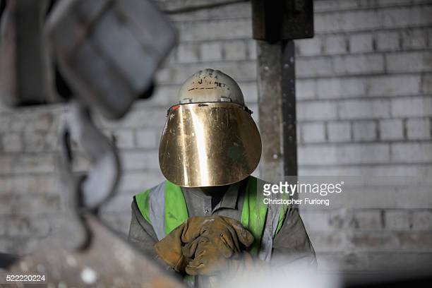 A worker tends to the furnace producing ferrotitanium during a visit to Tivac Alloys by UKIP leader Nigel Farage to see first hand how the global...