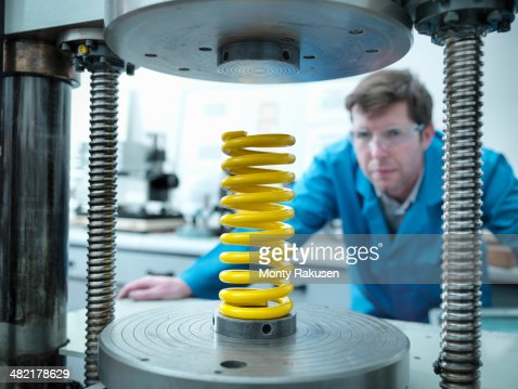 Worker testing spring for durability in laboratory