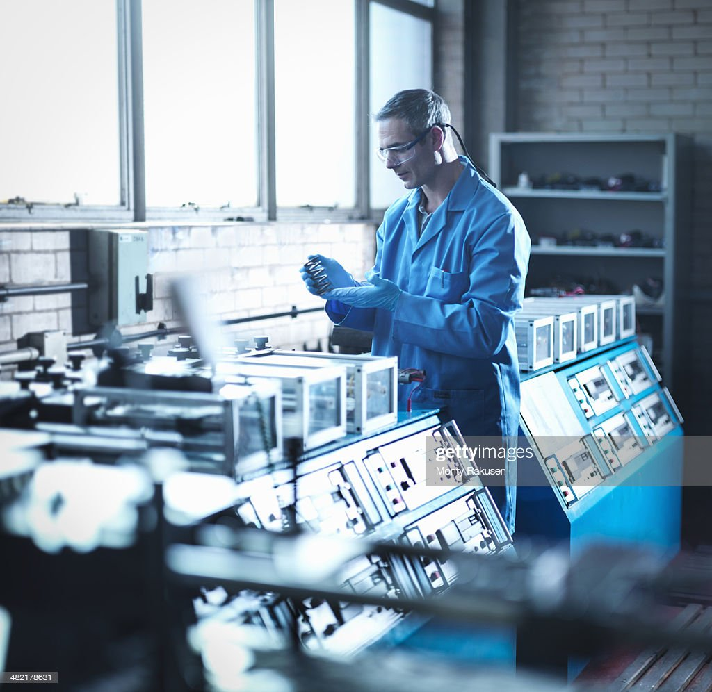 Worker testing spring in laboratory