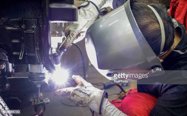 Worker tig welding to bumper repair at mohenic garages in Paju South Korea A 20yearold beat up Hyundai SUV isn't anyone's idea of a dream car But...