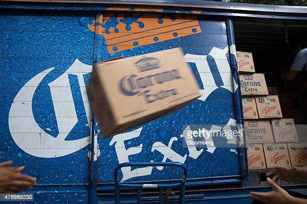 A worker tosses a case of Constellation Brands Inc Corona beer during a delivery in the Zona Rosa neighborhood in Mexico City Mexico on Wednesday...