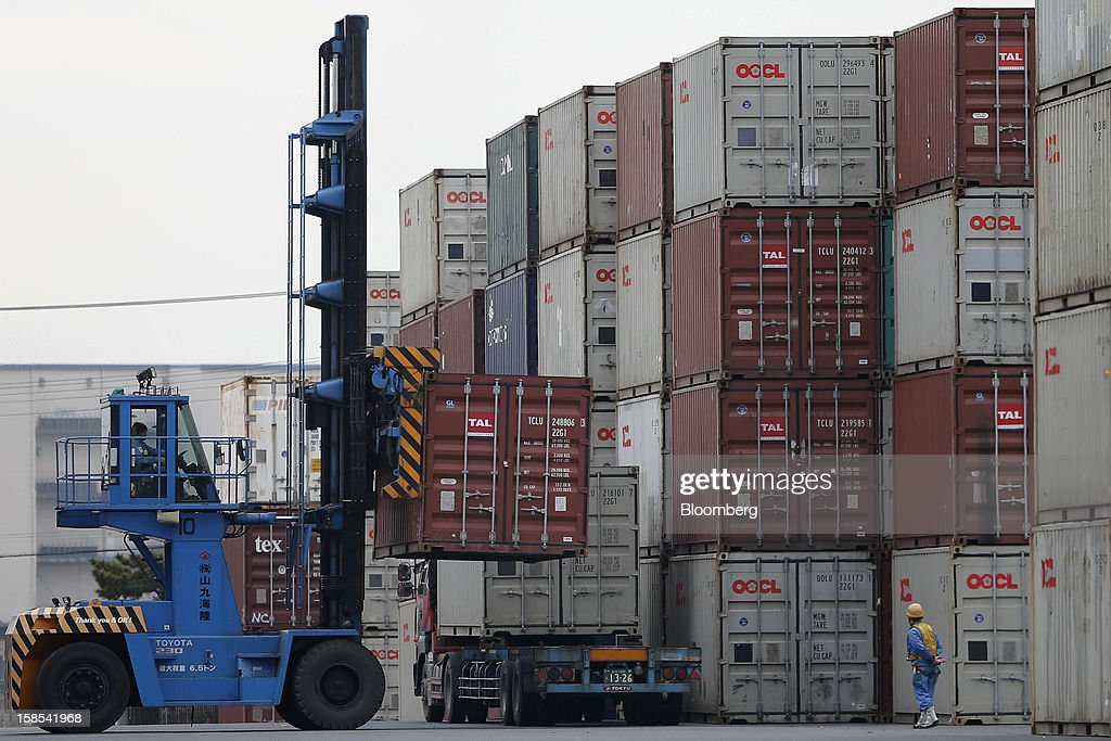 A worker unloads a container off a truck with a forklift at a container terminal in Tokyo, Japan, on Tuesday, Dec. 18, 2012. Japan's exports fell for a sixth month in November and the trade deficit swelled, underscoring the challenge that incoming Prime Minister Shinzo Abe faces in reviving growth. Photographer: Kiyoshi Ota/Bloomberg via Getty Images