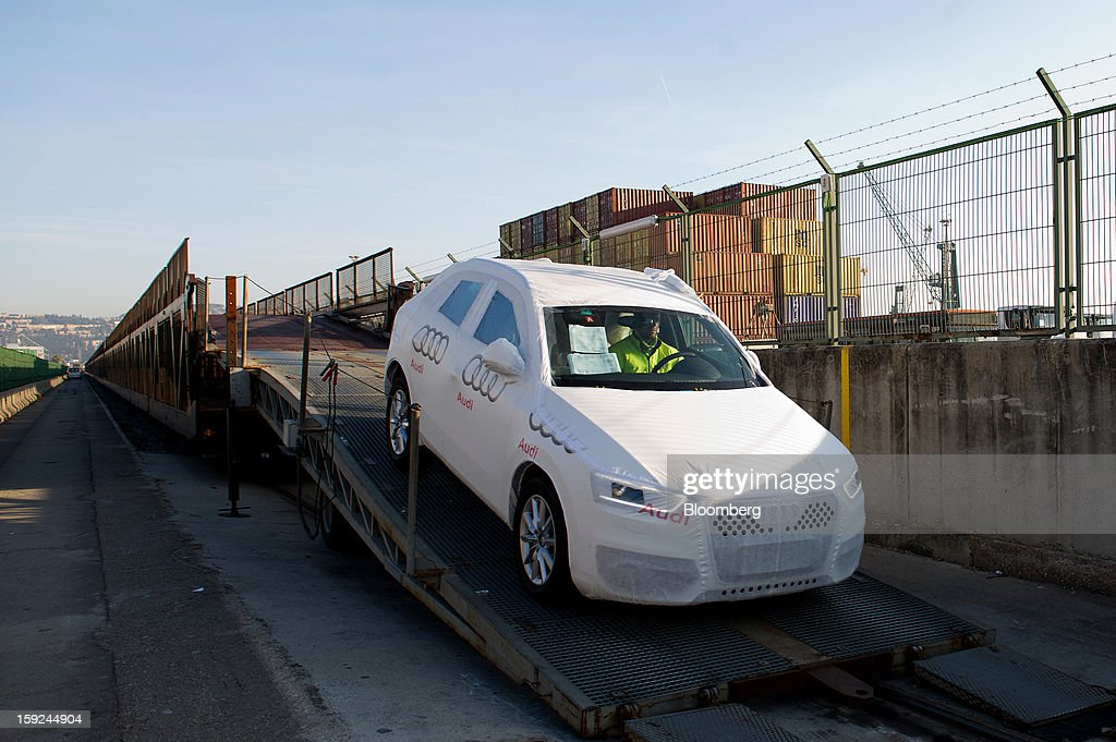 A worker unloads a new Audi AG automobile from a freight train ahead of shipping at Barcelona port in Barcelona, Spain, on Thursday, Jan. 10, 2013. Spanish exports grew the least in five months in September as the euro area relapsed into a recession and the region's fourth-largest economy continued to contract. Photographer: David Ramos/Bloomberg via Getty Images