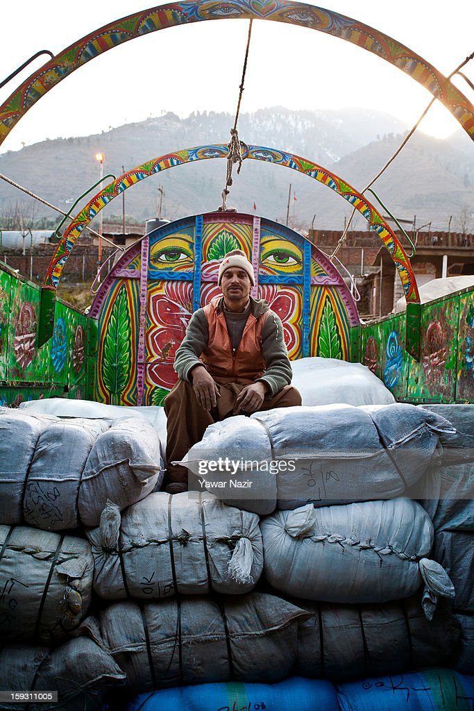 A worker unloads goods from Pakistani vehicles at the trade facilitation centre in the border area near Uri on January 11, 2013 in Salamabad, 120 km (75 miles) northwest of Srinagar, the summer capital of Indian Administered Kashshmir, India. People living in the mountainous region along the Line of Control (LOC), a military line that divides Indian-administered Kashmir from the Pakistan-administered Kashmir have continually been at risk due to hostility between the armies of the two rival nations, but trade has been carried out smoothly across the Line of Control in North Kashmir. Two Indian and two Pakistani soldiers have been killed in the last week near the Line of Control dividing Kashmir, with both countries blaming each other for the escalating tension.
