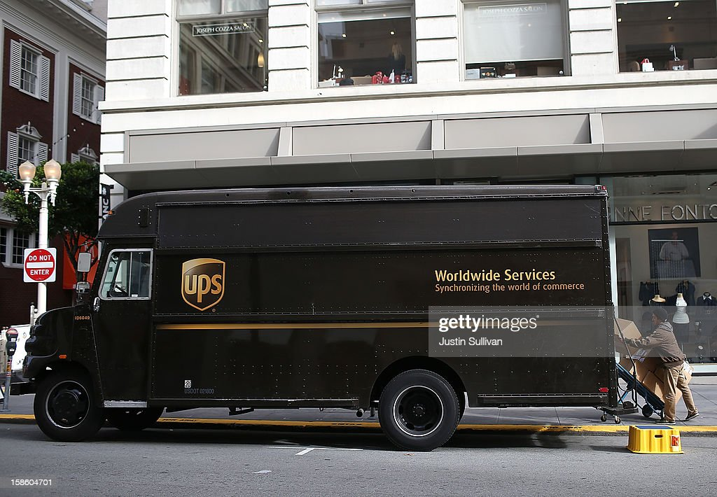 A UPS worker unloads packages from his truck on December 20, 2012 in San Francisco, California. With less than one week to go before Christmas, today is expected to be the busiest day in the history of UPS and they are expecting to ship an estimated 28 million packages around the globe.
