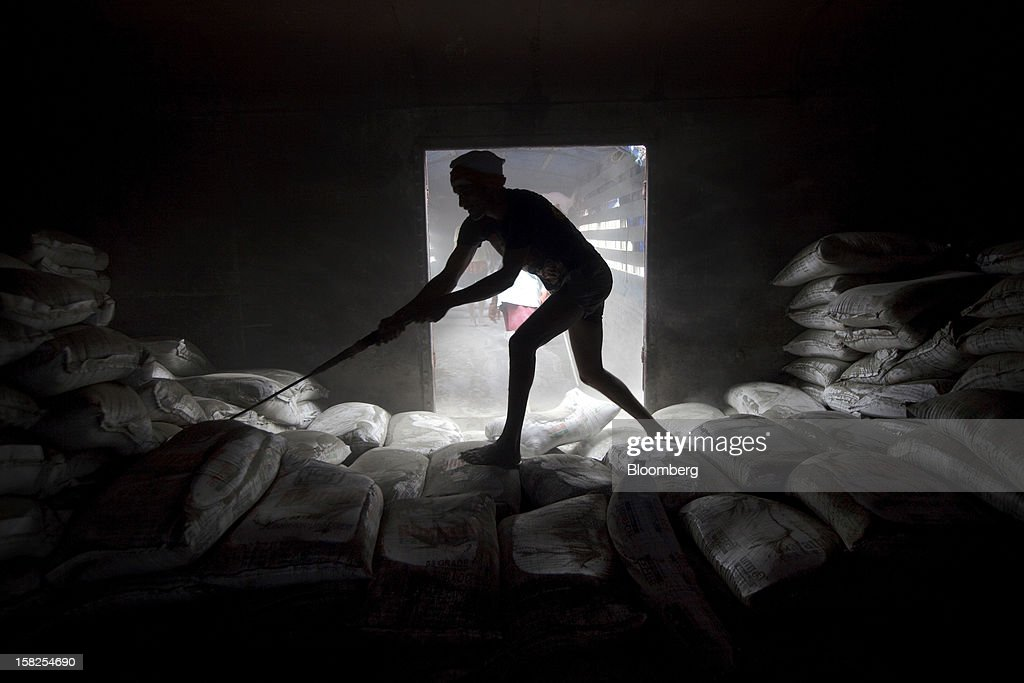 'BEST PHOTOS OF 2012' (): A worker unloads sacks of cement from a freight train in Mumbai, India, on Tuesday, Sept. 11, 2012. India, Asia's third-largest economy, grew 5.5 percent in the three months ended June 30 after expanding 5.3 percent in the previous quarter, the least in three years. Photographer: Kuni Takahashi/Bloomberg via Getty Images