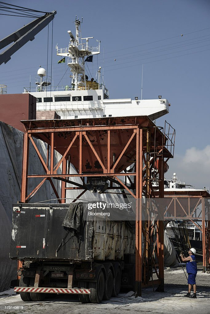 A worker unloads salt onto a truck at the Port of Santos in Santos, Brazil, on Friday, July 5, 2013. Rising borrowing costs and the global bond selloff triggered by the prospect of reduced U.S. stimulus are prompting Brazilian investors to boost holdings of the countrys floating-rate securities. Photographer: Paulo Fridman/Bloomberg via Getty Images