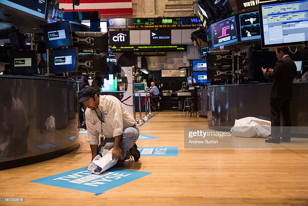 A worker unveils a floor mat bearing the logo of Twitter and the symbol on which Twitter's stock will traded (TWTR) on the floor of the New York Stock Exchange (NYSE) on November 7, 2013 in New York City. Twitter goes public on the NYSE today, it is expected to open at USD 26 per share, making the company worth an estimated USD 18 billion.