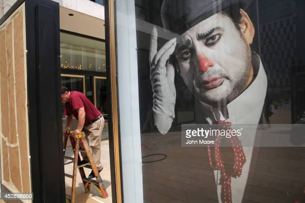 A worker unveils advertisement for future productions at the Metropolitan Opera on July 29 2014 at Lincoln Center in New York City The Metropolitan...