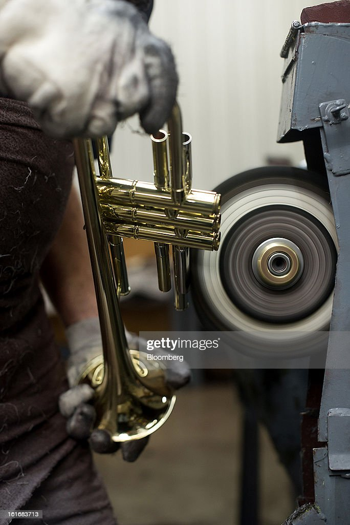 A worker uses a buffing wheel to remove imperfections on an assembled trumpet in the manufacturing department of the E.K Blessing Co. in Elkhart, Indiana, U.S., on Thursday, Feb. 7, 2013. The U.S. Federal Reserve is schedule to release industrial productions figures on Feb. 15. Photographer: Ty Wright/Bloomberg via Getty Images