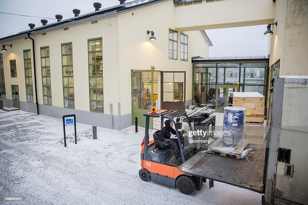 A worker uses a fork lift truck to unload a lorry at the 'New Carnegie Brewery,' also known as Nya Carnegibryggeriet, operated by Brooklyn Brewery Corp. in collaboration with D. Carnegie & Co., the Swedish unit of Carlsberg A/S, in Stockholm, Sweden, on Friday, Jan. 31, 2014. Brooklyn has teamed up with the Swedish unit of Carlsberg A/S, D. Carnegie & Co. and a few private investors to create 'The New Carnegie Brewery,' with an annual capacity of 1 million liters. Photographer: Casper Hedberg/Bloomberg via Getty Images