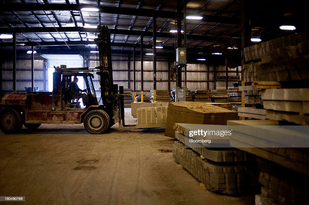 A worker uses a forklift to stack slabs of sandstone at the Cleveland Quarries facility in Vermilion, Ohio, U.S., on Friday, Feb. 1, 2013. Spending on U.S. construction projects climbed more than forecast in December, showing the housing industry is sustaining gains that may lift the economy. Photographer: Ty Wright/Bloomberg via Getty Images
