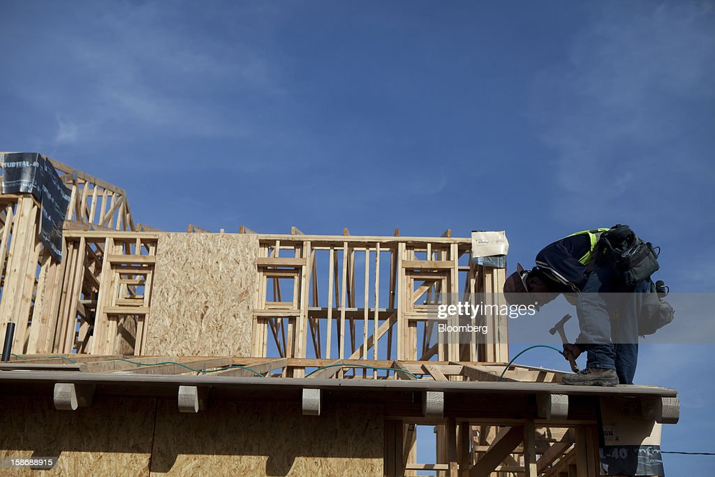 A worker uses a hammer during construction of a house at Davidson Communities LLC's Arista at The Crosby development in Rancho Santa Fe, California, U.S., on Friday, Dec. 21, 2012. New home sales climbed to a 380,000 annual rate in November, the most since April 2010, according to the median forecast of 60 economists surveyed by Bloomberg before Dec. 27 figures from the Commerce Department. Photographer: Sam Hodgson/Bloomberg via Getty Images