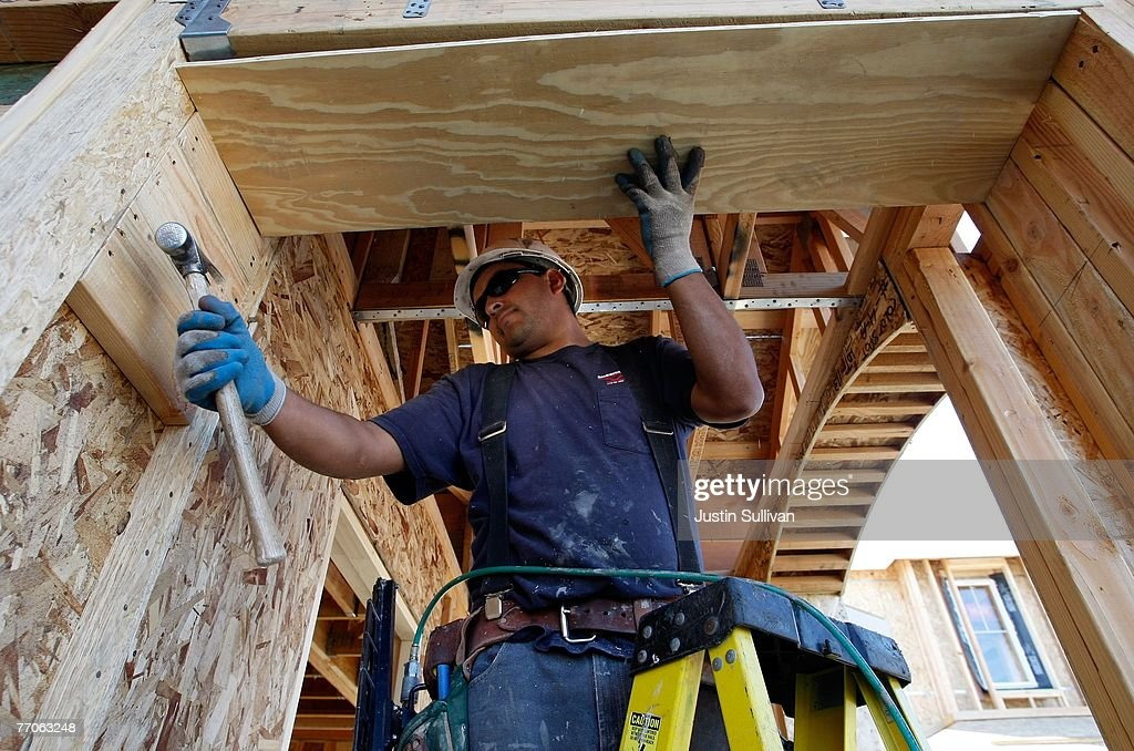 A worker uses a hammer while building a new home at a housing development September 27, 2007 in Richmond, California.Tthe Commerce Department reported today that sales of new homes fell 8.3 percent in August, bringing sales to an annual rate of 795,000 units, the lowest level since June 2007.