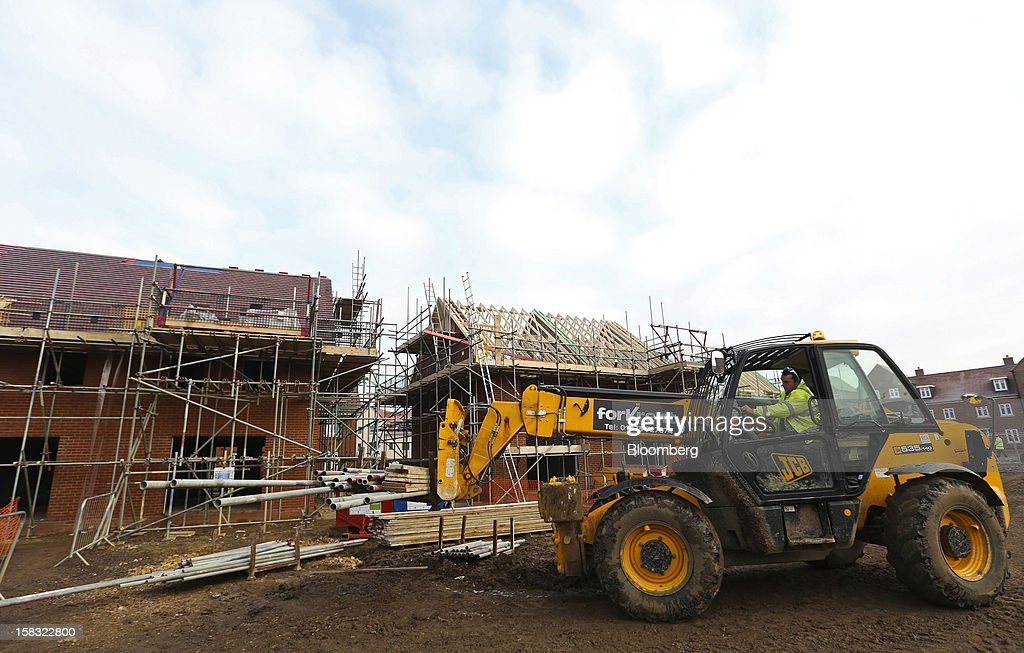 A worker uses a JC Bamford Excavators Ltd. (JCB) forklift truck to move building materials around a Barratt Developments Plc construction site for residential housing in Bedford, U.K., on Thursday, Dec. 13, 2012. Barratt Developments Plc, the U.K.'s largest homebuilder by volume, said advance sales rose 21 percent as government initiatives to boost homebuilding lifted private reservations in the autumn selling season. Photographer: Chris Ratcliffe/Bloomberg via Getty Images