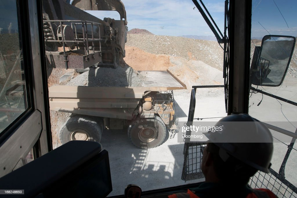 A worker uses a mining shovel machine to load a dump truck with copper material at Grupo Mexico SAB's La Caridad open pit copper mine in Sonora, Mexico, on Monday, May 6, 2013. Grupo Mexico SAB, Mexico's biggest mining company by market value, estimates it will produce 840,000 tons of copper in 2013. Photographer: Susana Gonzalez/Bloomberg via Getty Images