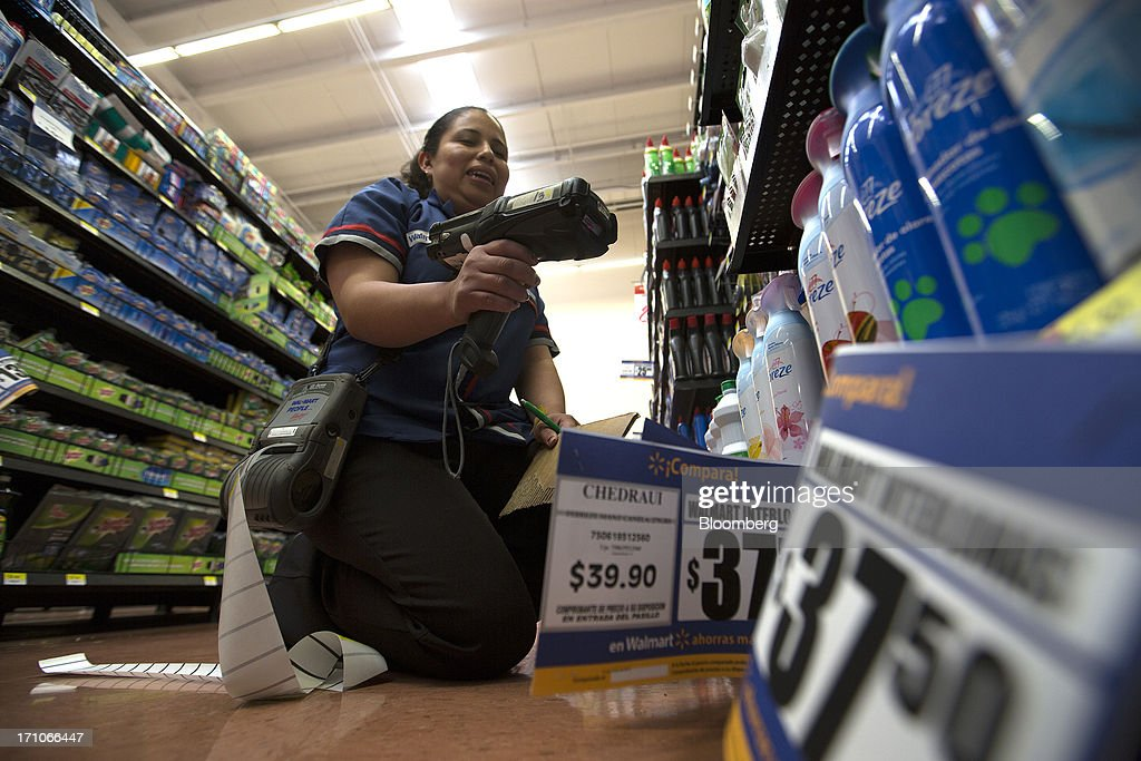 A worker uses a price machine to change at a Wal-Mart Stores Inc. location in Mexico City, Mexico, on Thursday, June 20, 2013. Mexican retail sales rose 2.5 percent in April from the same month last year, the country's statistics agency, known as Inegi, reported on its website. Photographer: Susana Gonzalez/Bloomberg via Getty Images